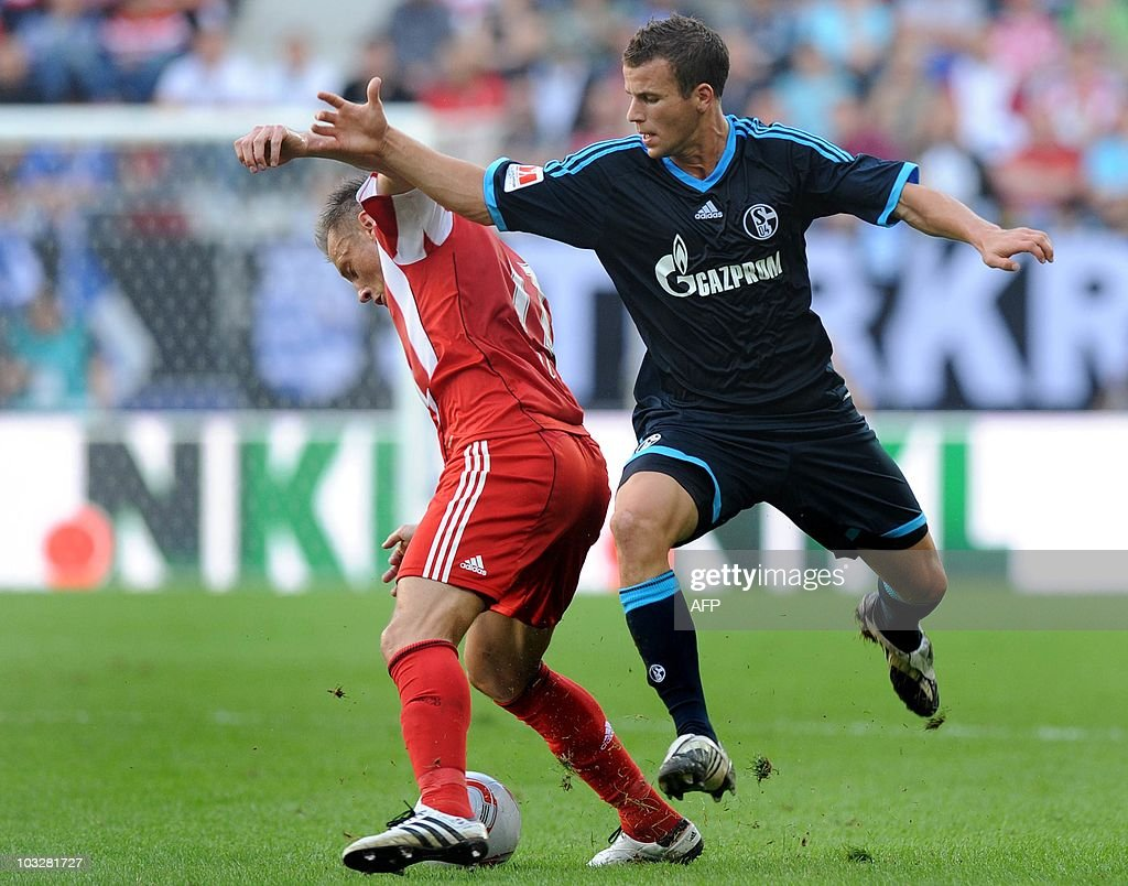 Bayern Munich's Croatian striker Ivica Olic (L) and Schalke's defender Christoph Moritz (R) challenge for the ball during the German football Super Cup final between German first division Bundesliga football teams FC Bayern Munich and Schalke 04 in the stadium in Augsburg, southern Germany, August 7, 2010.