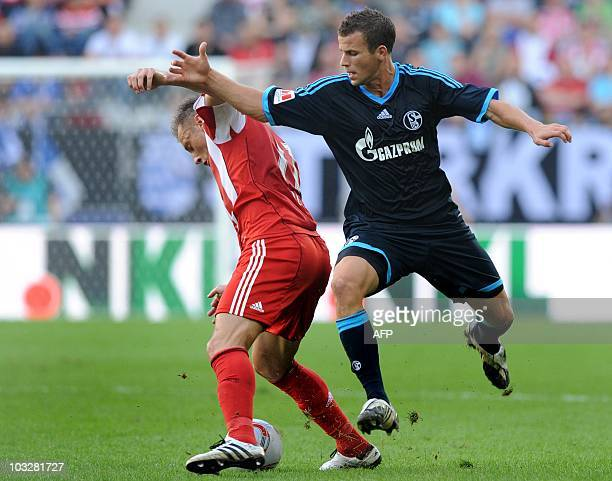 Bayern Munich's Croatian striker Ivica Olic and Schalke's defender Christoph Moritz challenge for the ball during the German football Super Cup final...