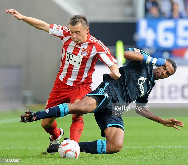 Bayern Munich's Croatian striker Ivica Olic and Schalke's midfielder Joel Matip challenge for the ball during the German football Super Cup final...