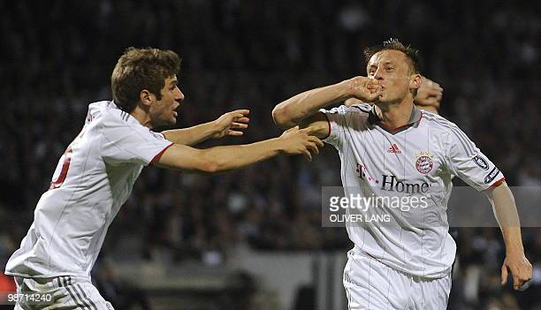 Bayern Munich's Croatian striker Ivica Olic celebrates scoring with his teammate striker Thomas Mueller during the 2nd leg UEFA Champions League...