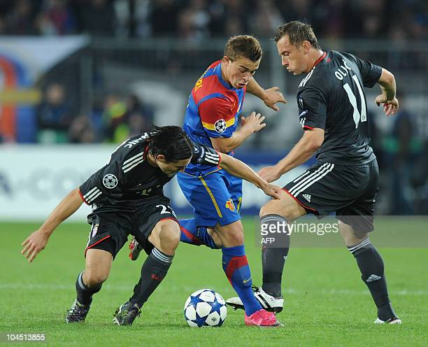 Bayern Munich's Croatian striker Ivica Olic his teammate Croatian midfielder Danijel Pranjic and Basel's Swiss midfielder Xherdan Shaqiri vie for the...