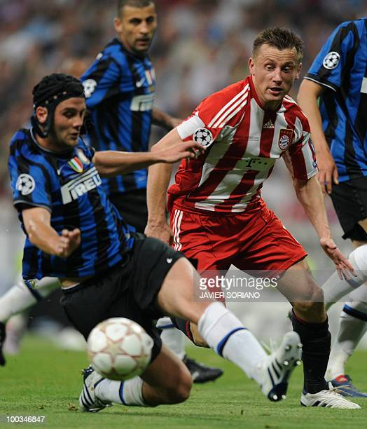 Bayern Munich's Croatian striker Ivica Olic is blocked during the UEFA Champions League final football match at the Santiago Bernabeu stadium in...