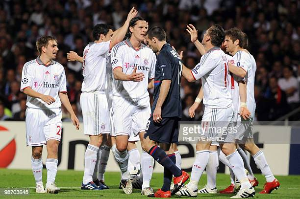 Bayern Munich's Croatian striker Ivica Olic is congratulated by his teammates after scoring a goal during the second leg UEFA Champions League...