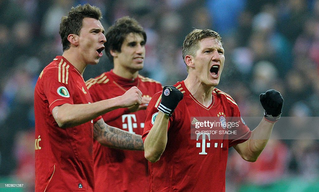 Bayern Munich's Croatian striker Mario Mandzukic, Bayern Bayern Munich's Spain midfielder Javi Martinez and Bayern Munich's midfielder Bastian Schweinsteiger celebrate after the German Cup quarter-final football match FC Bayern Munich vs Borussia Dortmund in Munich, southern Germany, on February 27, 2013. Bayern Munich won the match 1-0. AFP PHOTO / CHRISTOF STACHE DURING THE MATCH AND PROHIBITS MOBILE (MMS) USE