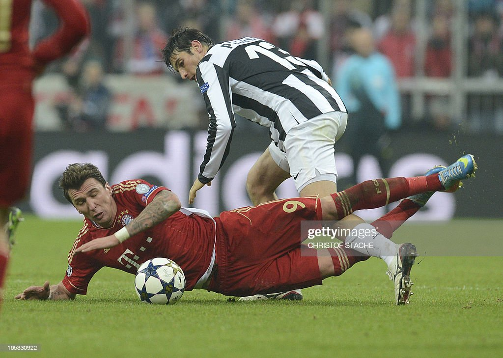 Bayern Munich's Croatian striker Mario Mandzukic (L) falls as he vies for the ball with Juventus' defender Federico Peluso (R) during the UEFA Champions League quarter final football match FC Bayern Munich vs Juventus Turin in Munich, southern Germany, on April 2, 2013.