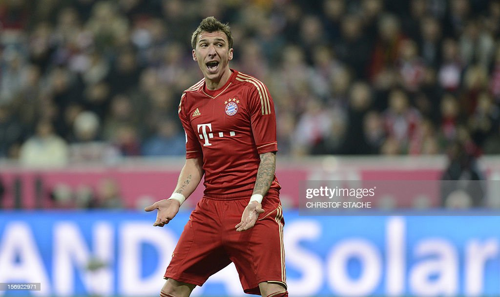 Bayern Munich's Croatian striker Mario Mandzukic gestures during the German first division Bundesliga football match FC Bayern Munich vs Hanover 96 in Munich, southern Germany, on November 24, 2012. Bayern Munich won the match 5-0. AFP PHOTO / CHRISTOF STACHE