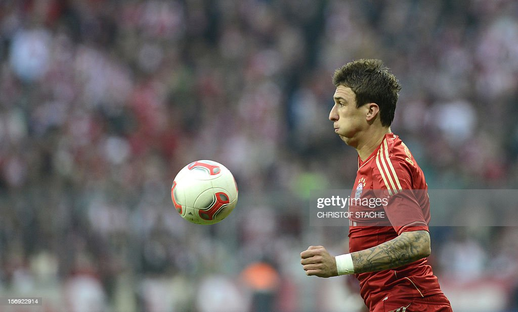 Bayern Munich's Croatian striker Mario Mandzukic plays the ball during the German first division Bundesliga football match FC Bayern Munich vs Hanover 96 in Munich, southern Germany, on November 24, 2012. Bayern Munich won the match 5-0.