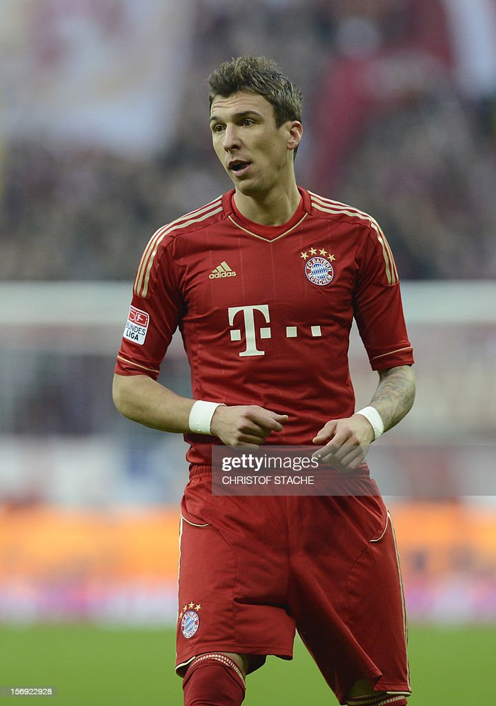 Bayern Munich's Croatian striker Mario Mandzukic reacts during the German first division Bundesliga football match FC Bayern Munich vs Hanover 96 in Munich, southern Germany, on November 24, 2012. Bayern Munich won the match 5-0. AFP PHOTO / CHRISTOF STACHE