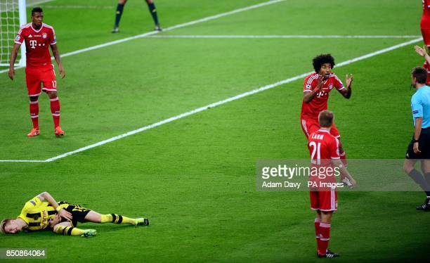 Bayern Munich's Dante after a foul on Borussia Dortmund's Marco Reus resulting in a penalty