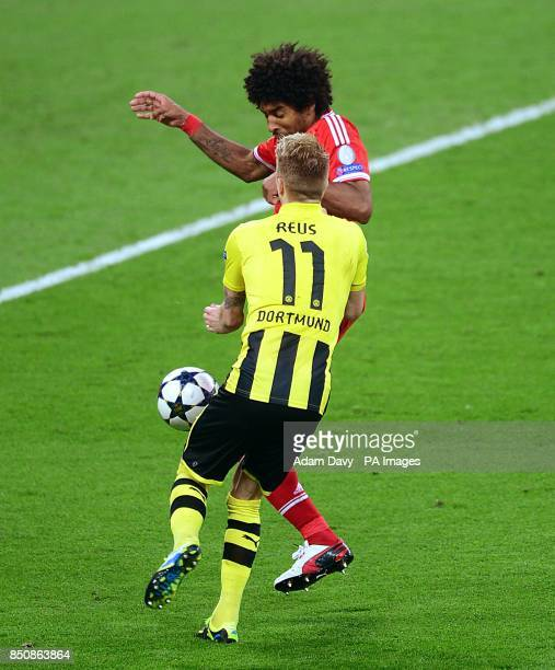 Bayern Munich's Dante fouls Borussia Dortmund's Marco Reus resulting in a penalty
