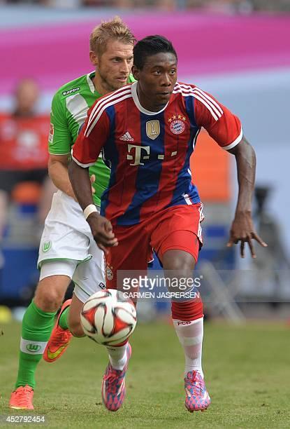 Bayern Munich's David Alaba vies for the ball with Wolfsburg's Aaron Hunt during the Telekom Cup final football match FC Bayern Munich vs Wolfsburg...
