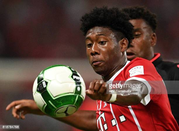 Bayern Munich's defender David Alaba and Arsenal forward Alex Iwobi vie for the ball during the International Champions Cup football match between...
