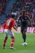 Bayern Munich's defender David Alaba vies with Benfica's midfielder Eduardo Salvio during the UEFA Champions League quarterfinal second leg football...