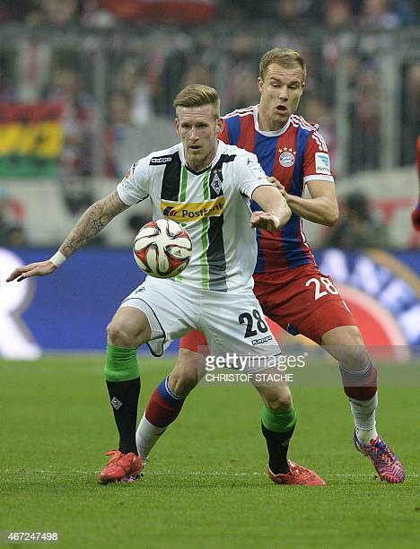 Bayern Munich's defender Holger Badstuber and Moenchengladbach's midfielder Andre Hahn vie for the ball during the German first division Bundesliga...