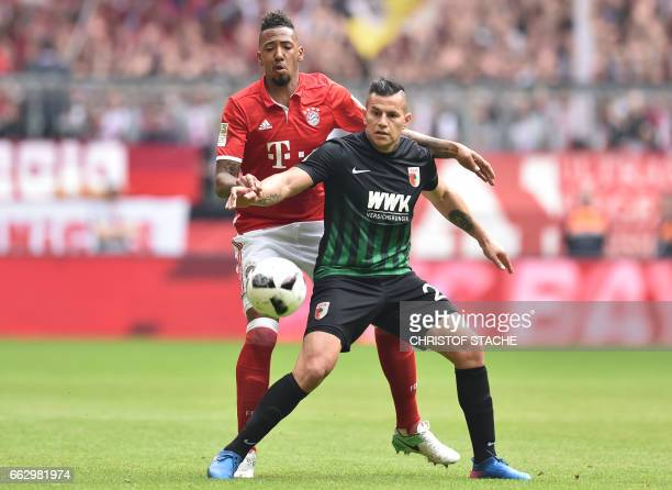 Bayern Munich's defender Jerome Boateng and Augsburg's Paraguayan striker Raul Bobadilla vie for the ball during the German first division Bundesliga...