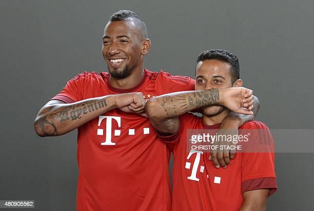 Bayern Munich's defender Jerome Boateng and Bayern Munich's Spanish midfielder Thiago Alcantara joke during a team photo of German first division...