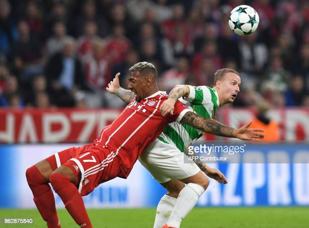 Bayern Munich's defender Jerome Boateng and Celtic's Scottish striker Leigh Griffiths vie for the ball during the Champions League group B match...