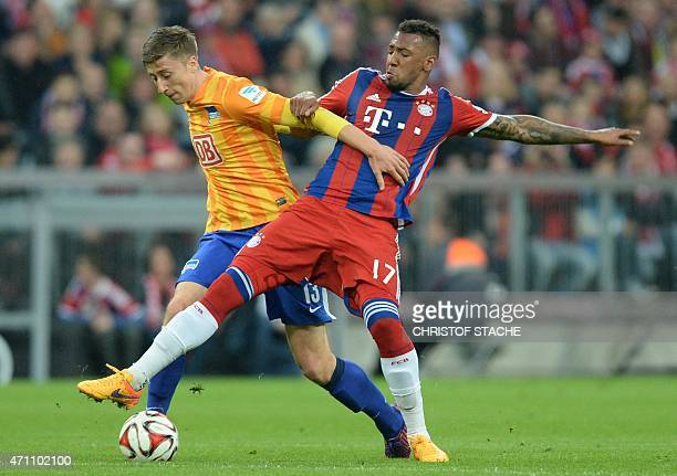 Bayern Munich's defender Jerome Boateng and Hertha's midfielder Jens Hegeler react during the German first division Bundesliga football match between...