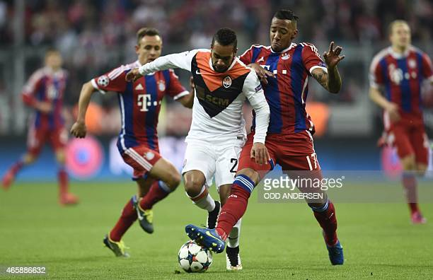 Bayern Munich's defender Jerome Boateng and Shakhtar Donetsk's Brazilian midfielder Alex Teixeira vie for the ball during the UEFA Champions League...