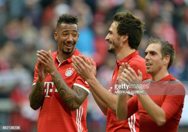 Bayern Munich's defender Jerome Boateng Bayern Munich's defender Mats Hummels and Bayern Munich's defender Philipp Lahm applaud after the German...