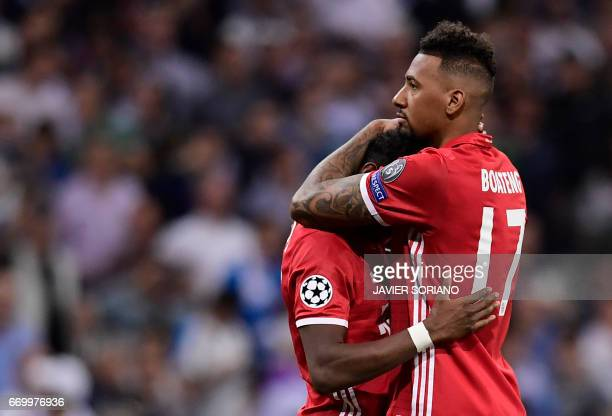 Bayern Munich's defender Jerome Boateng hugs Bayern Munich's Austrian defender David Alaba at the end of the UEFA Champions League quarterfinal...
