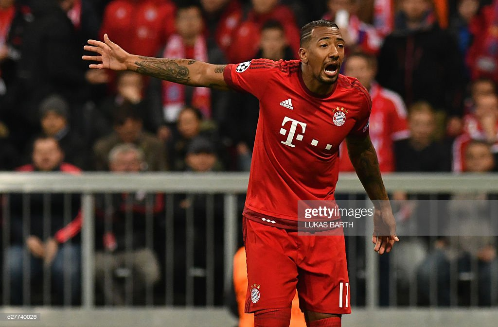 Bayern Munich's defender Jerome Boateng reacts during the UEFA Champions League semi-final, second-leg football match between FC Bayern Munich and Atletico Madrid in Munich, southern Germany, on May 3, 2016. / AFP / LUKAS