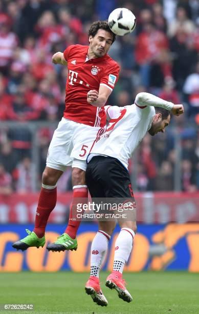 Bayern Munich's defender Mats Hummels and Mainz' midfielder Levin Oeztunali vie for the ball during the German first division Bundesliga football...