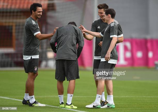 Bayern Munich's defender Mats Hummels Bayern Munich's defender Marco Friedl Bayern Munich's defender Niklas Suele and Bayern Munich's midfielder...