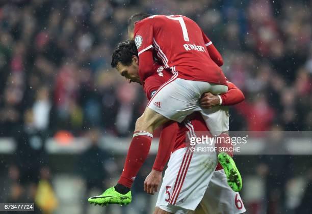 Bayern Munich's defender Mats Hummels Bayern Munich's Spanish midfielder Thiago Alcantara and Bayern Munich's French midfielder Franck Ribery...