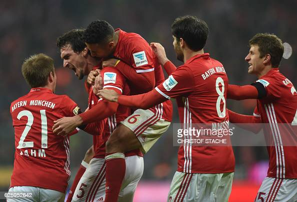 Bayern Munich's defender Mats Hummels celebrates scoring with his teammates during the German first division Bundesliga football match between FC...