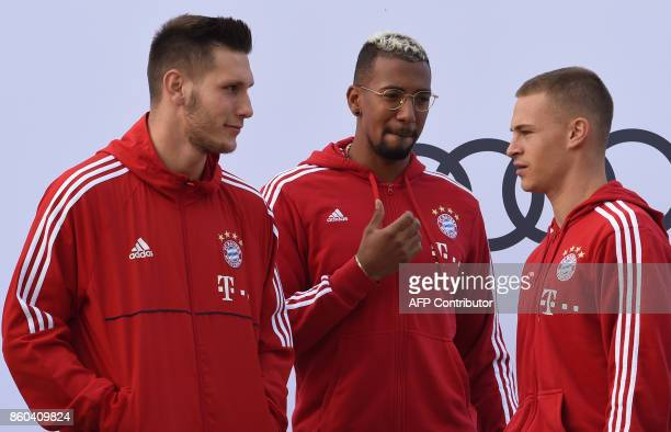 Bayern Munich's defender Niklas Suele Bayern Munich's defender Jerome Boateng and Bayern Munich's midfielder Joshua Kimmich are pictured during a car...