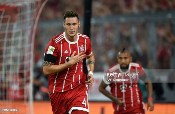 Bayern Munich's defender Niklas Suele celebrates scoring the opening goal of the season during the German First division Bundesliga football match FC...