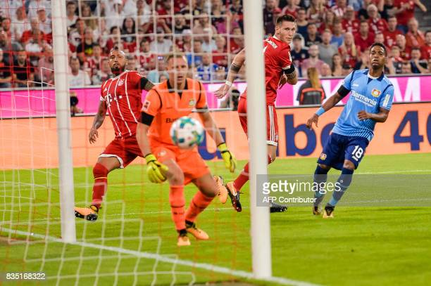 Bayern Munich's defender Niklas Suele score the opening goal of the season past Leverkusen's goalkeeper Bernd Leno during the German First division...