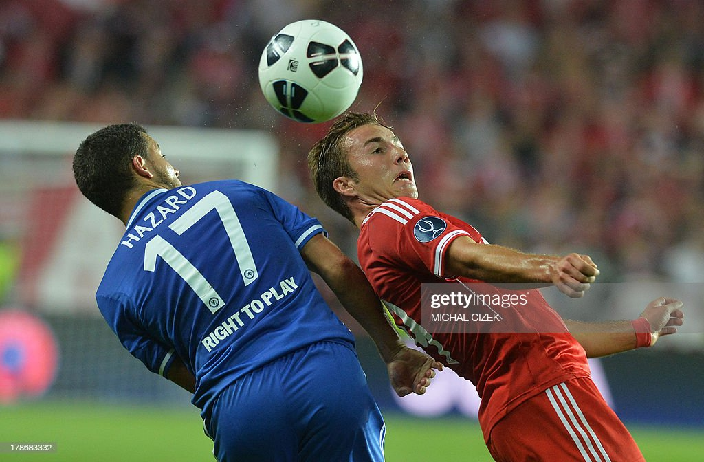 Bayern Munich's defender Philipp Lahm (R) and Chelsea's Belgian midfielder Eden Hazard vie for the ball during the UEFA Super Cup football match FC Bayern Munich vs Chelsea FC on August 30, 2013 at the Eden Stadium, in Prague.