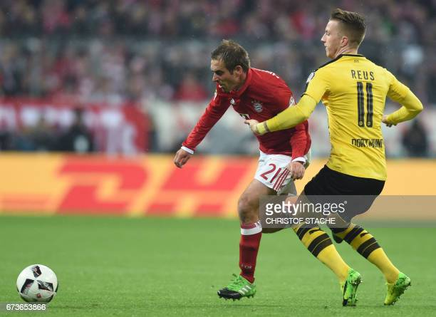 Bayern Munich's defender Philipp Lahm and Dortmund's forward Marco Reus vie for the ball during the German Cup DFB Pokal semifinal football match...