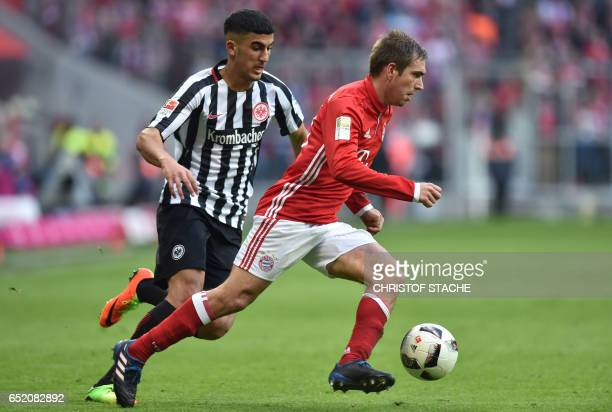Bayern Munich's defender Philipp Lahm and Frankfurt's midfielder Aymen Barkok vie for the ball during the German First division Bundesliga football...