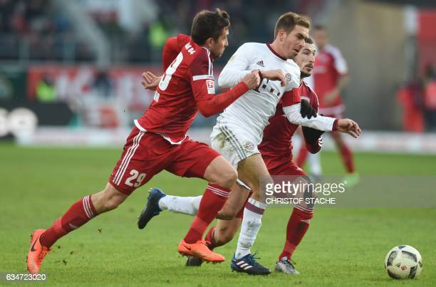 Bayern Munich's defender Philipp Lahm and Ingolstadt's Australian striker Mathew Leckie vie for the ball during the German First division Bundesliga...