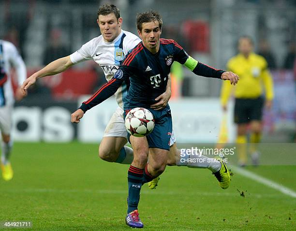 Bayern Munich's defender Philipp Lahm and Manchester City's midfielder James Milner vie for the ball during the UEFA Champions League group D...