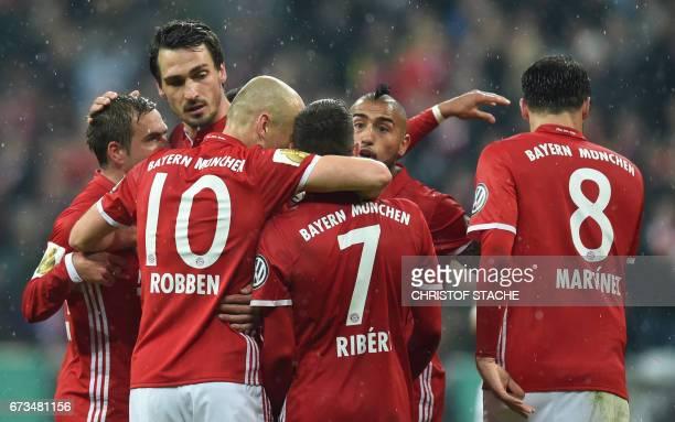 Bayern Munich's defender Philipp Lahm Bayern Munich's defender Mats Hummels Bayern Munich's Dutch midfielder Arjen Robben Bayern Munich's French...