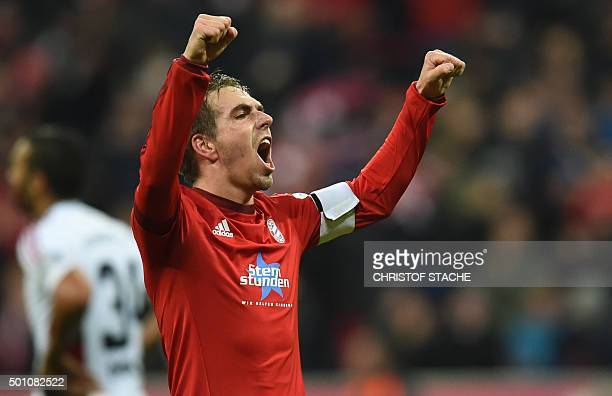 TOPSHOT Bayern Munich's defender Philipp Lahm celebrates after the second goal for Munich during the German first division Bundesliga football match...