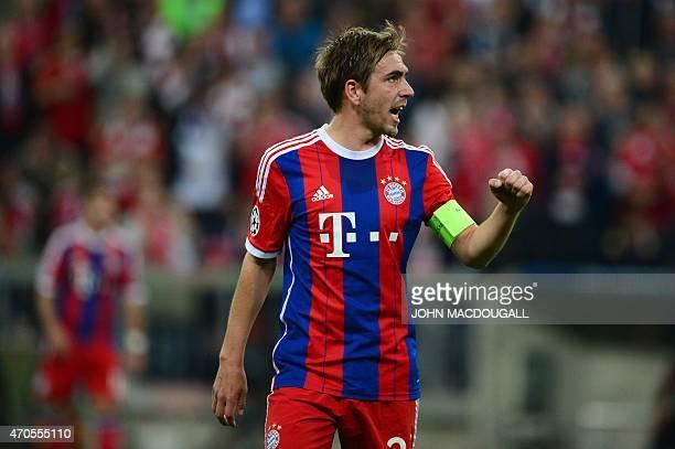 Bayern Munich's defender Philipp Lahm celebrates the 20 goal during the UEFA Champions League secondleg quarterfinal football match Bayern Munich v...