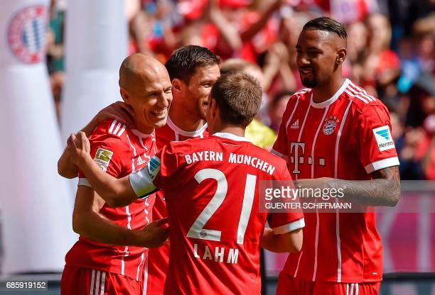 TOPSHOT Bayern Munich's defender Philipp Lahm celebrates the first goal with Bayern Munich's Dutch midfielder Arjen Robben and teammates during the...