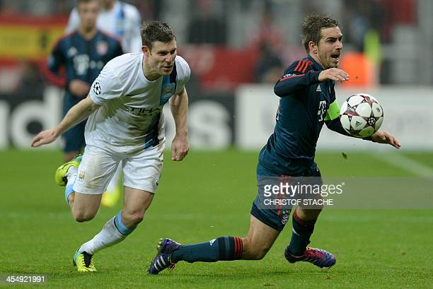 Bayern Munich's defender Philipp Lahm falls after an attack of Manchester City's midfielder James Milner during the UEFA Champions League group D...