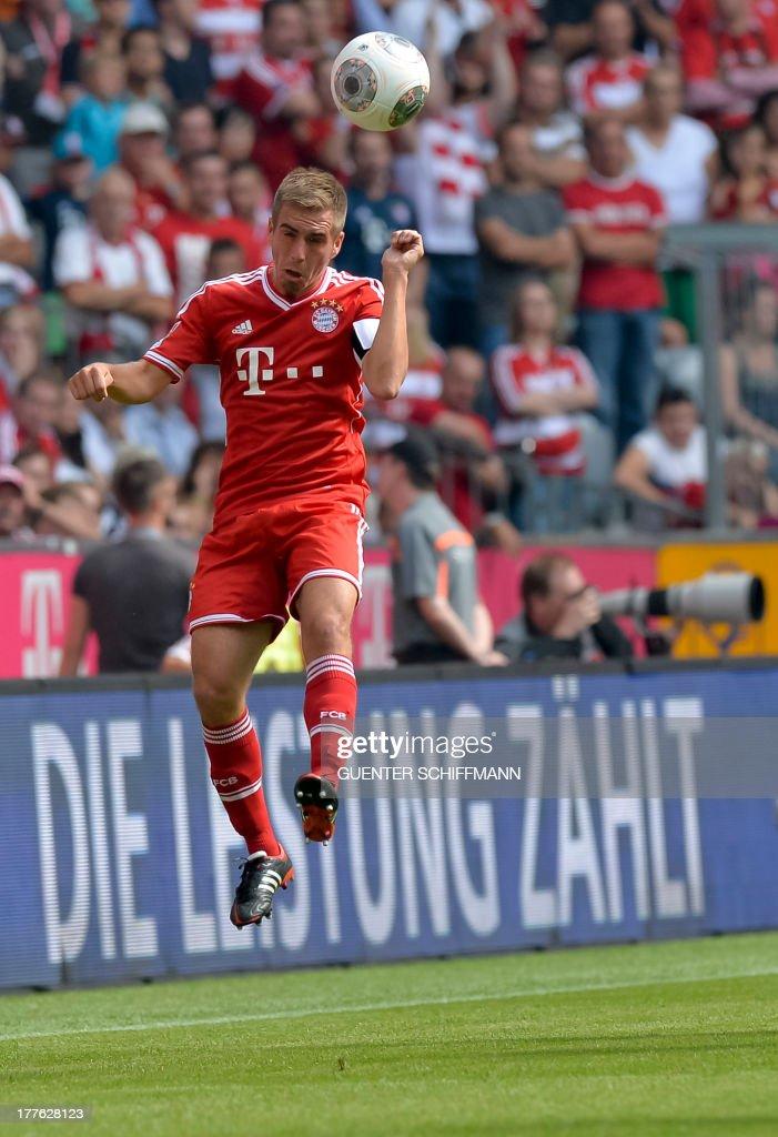 Bayern Munich's defender Philipp Lahm heads the ball during the German first division Bundesliga football match FC Bayern Munich vs FC Nuremberg in Munich, southern Germany on August 24, 2013. Bayern Munich won the match 2-0.