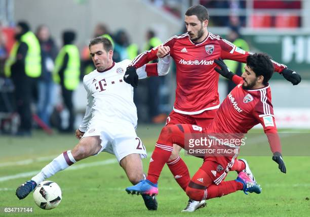 Bayern Munich's defender Philipp Lahm Ingolstadt's Australian striker Mathew Leckie and Ingolstadt's Israeli midfielder Almog Cohen vie for the ball...