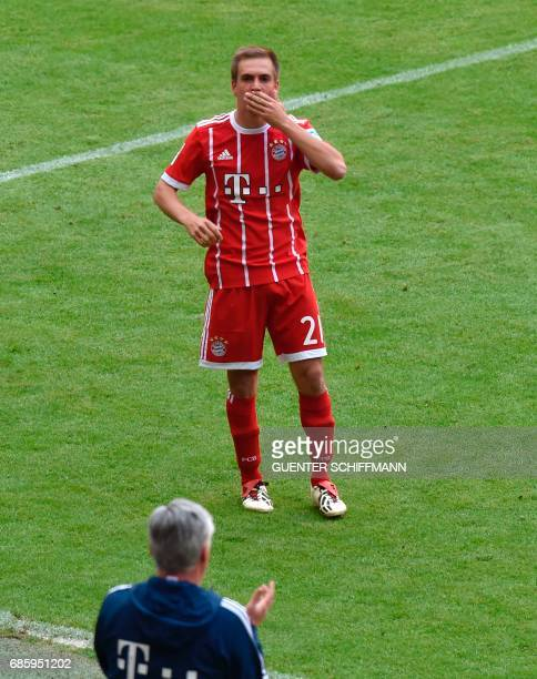 Bayern Munich's defender Philipp Lahm reacts as he leaves the pitch during the German First division Bundesliga football match Bayern Munich vs SC...
