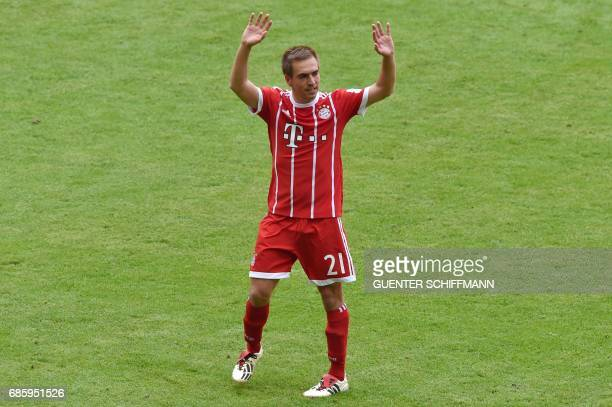 TOPSHOT Bayern Munich's defender Philipp Lahm waves to the crowds during the German first division Bundesliga football match FC Bayern Munich vs SC...