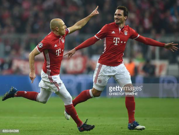 Bayern Munich's Dutch midfielder Arjen Robben and Bayern Munichs defender Mats Hummels celebrate after the first goal during the UEFA Champions...