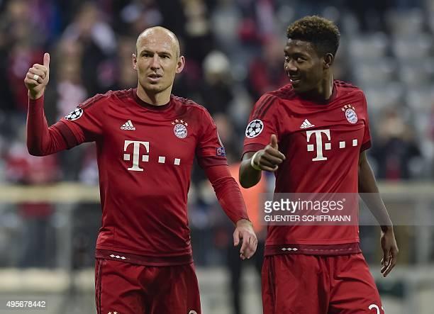 Bayern Munich's Dutch midfielder Arjen Robben and Bayern Munich's Austrian midfielder David Alaba celebrate after the UEFA Champions League Group F...