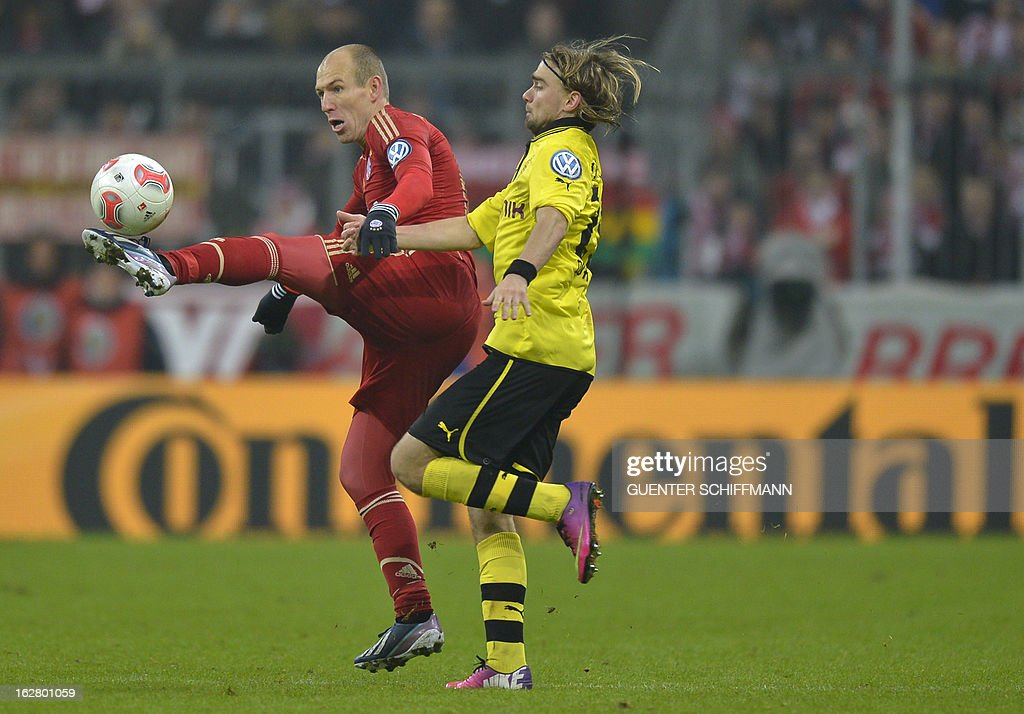 Bayern Munich's Dutch midfielder Arjen Robben (L) and Dortmund's German defender Marcel Schmelzer vie for the ball during the German Cup quarter-final football match FC Bayern Munich vs Borussia Dortmund in Munich, southern Germany, on February 27, 2013. Bayern Munich won the match 1-0. AFP PHOTO / GUENTER SCHIFFMANN DURING THE MATCH AND PROHIBITS MOBILE (MMS) USE